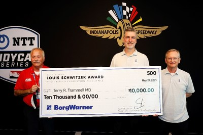 John Norton and Steve Sholman award $10,000 check to Dr. Terry R. Trammell for 2021 Louis Schwitzer Award