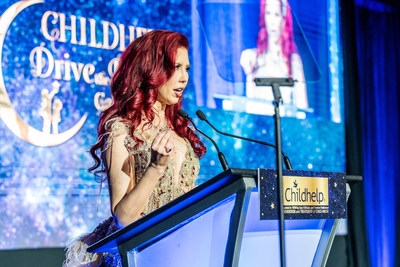 The VibrantDoc Stacie J. Stephenson Accepting the Childhelp Woman of the World Award