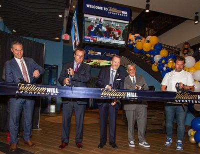 (Left to right) Eric Hession (Co-President - Caesars Sports & Online Gaming), Tom Reeg (CEO - Caesars Entertainment), Jim Van Stone (President, Business Operations & Chief Commercial Officer - Monumental Sports & Entertainment), Ted Leonsis (Founder & CEO - Monumental Sports & Entertainment) and Nicholas Stefanelli (Michelin-Starred Chef) perform a ceremonial ribbon cutting as William Hill and Monumental Sports & Entertainment celebrate the grand opening of the William Hill Sportsbook, America's first in-arena sportsbook, at Capital One Arena on Wednesday, May 26, 2021 in Washington D.C. (Credit William Hill)