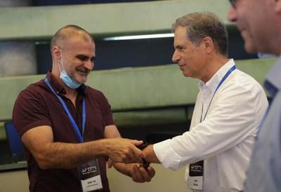 Meni Itzhak, CardiacSense VP R&D, with Eytan Stibbe, Israeli second astronaut. Credit: Elad Malka (PRNewsfoto/CardiacSense)