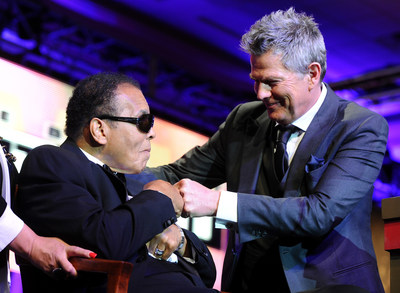 David Foster and Muhammad Ali bump fists at Celebrity Fight Night in 2013. Photo courtesy of PHIL GUDENSCHWAGER