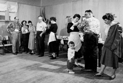 Two Public Health Nurses are vaccinating adults at a polio clinic in Southey, SK, courtesy of Library and Archives Canada (CNW Group/Public Health Agency of Canada)