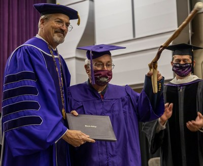 """Lincoln College President David Gerlach pictured with William """"Bill"""" Gossett at Commencement."""