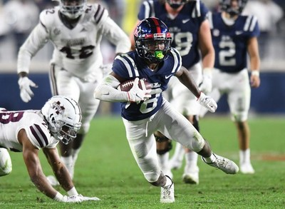 Ole Miss wide receiver Elijah Moore (8) makes a catch against Mississippi State Bulldog defenders during Nov. 28, 2020 SEC game in Oxford, Mississippi. Moore won the C Spire Conerly Trophy Monday as the best college football player in Mississippi. - photo courtesy of SEC Media Pool