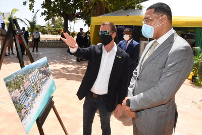 Sandals Resorts International's Executive Chairman, Adam Stewart, CD, and Prime Minister, The Most Hon. Andrew Holness, ON, MP, surveying plans for the future Sandals Dunn's River and Sandals Royal Dunn's River resorts.