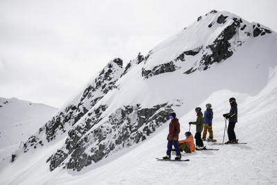 Friends skiing and snowboarding with a Mountain Host in Whistler Blackcomb. Source: Strain