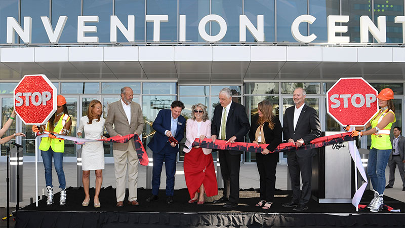 Dignitaries and representatives from the Las Vegas Convention & Visitors Authority and Informa Markets participate in a ribbon cutting ceremony