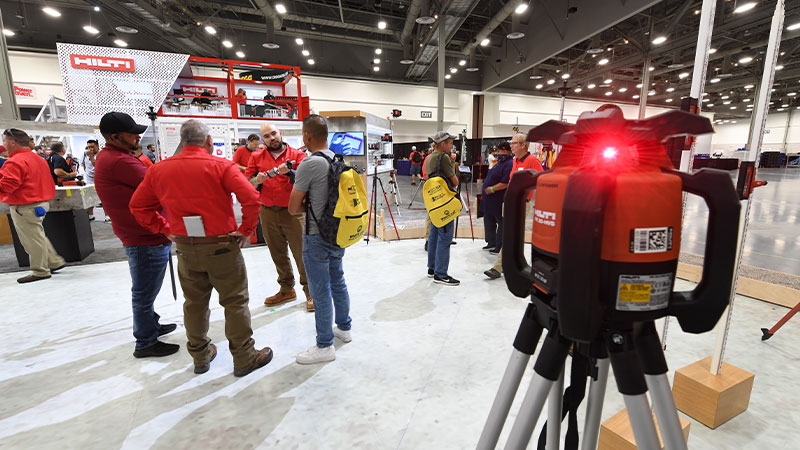 Attendees chat on the West Hall exhibit floor at the 2021 World of Concrete