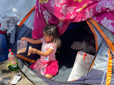 A young girl in the tent city, in Tijuana Mexico, as the border crisis worsens. NewsBlaze photo by Nurit Greenger.